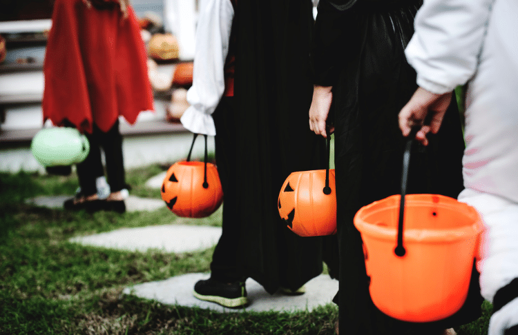 If your community isn't hosting a trick-or-treating event, host one for your halloween promotion.