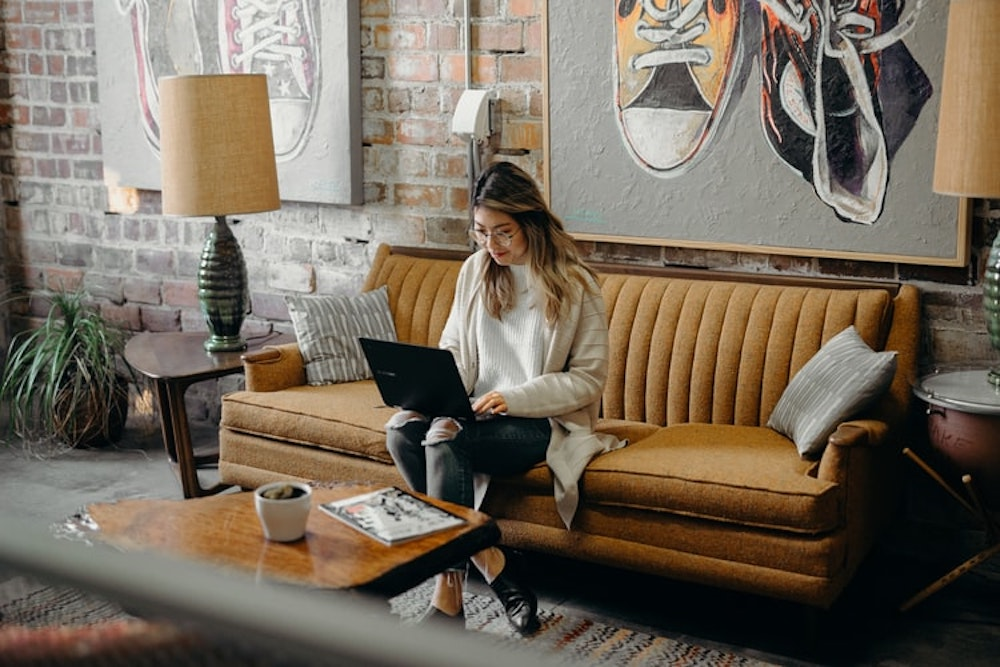 monthly email newsletter topics and ideas-girl reading email on couch